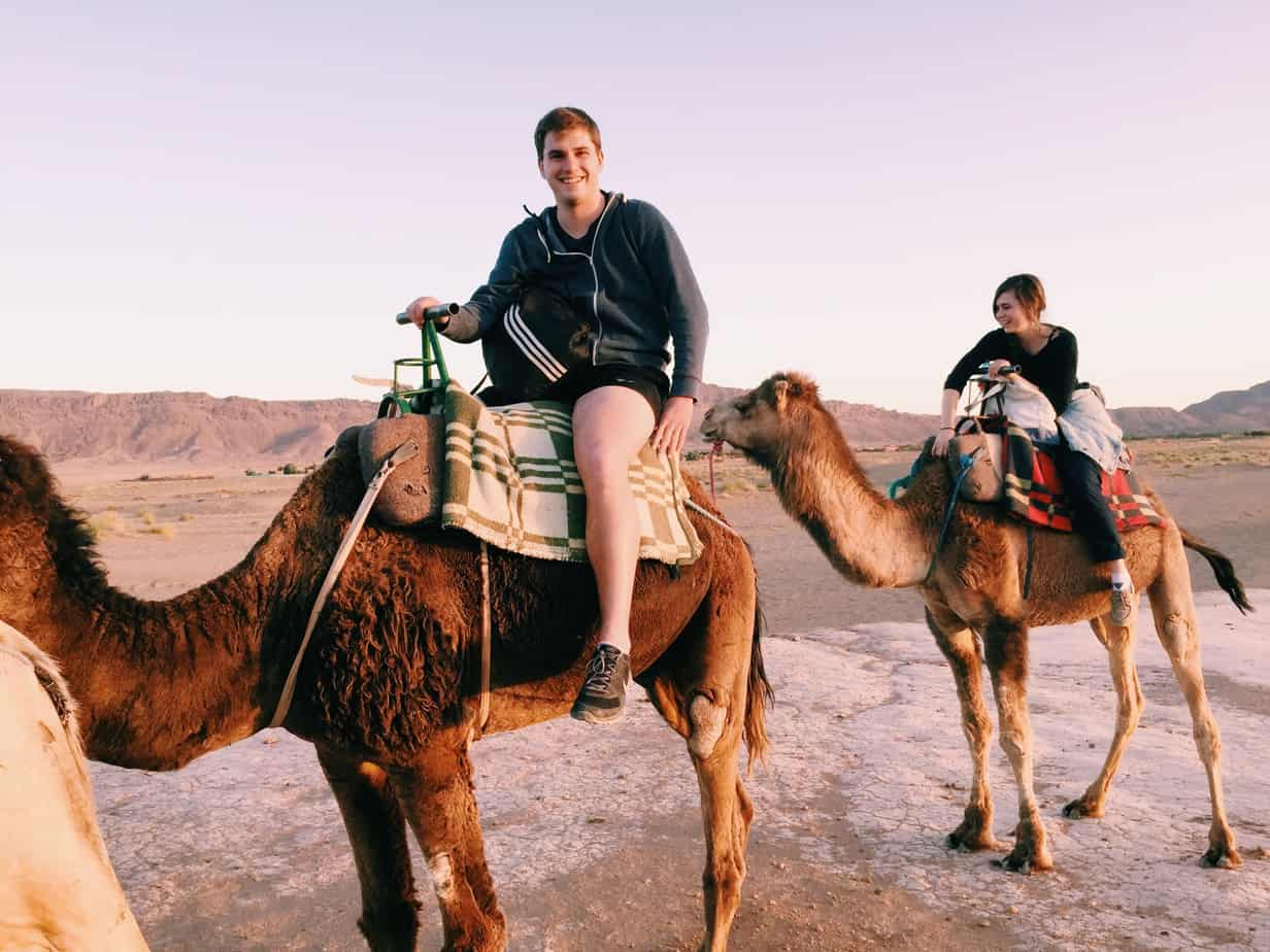 When in Morocco, go on a life changing Sahara Desert tour from Marrakech. We loved our tour and 45 minute camel ride. In this post I discuss common questions, and compare the best Marrakech tours to the Sahara Desert, including why I would NOT go with the company we went with again.