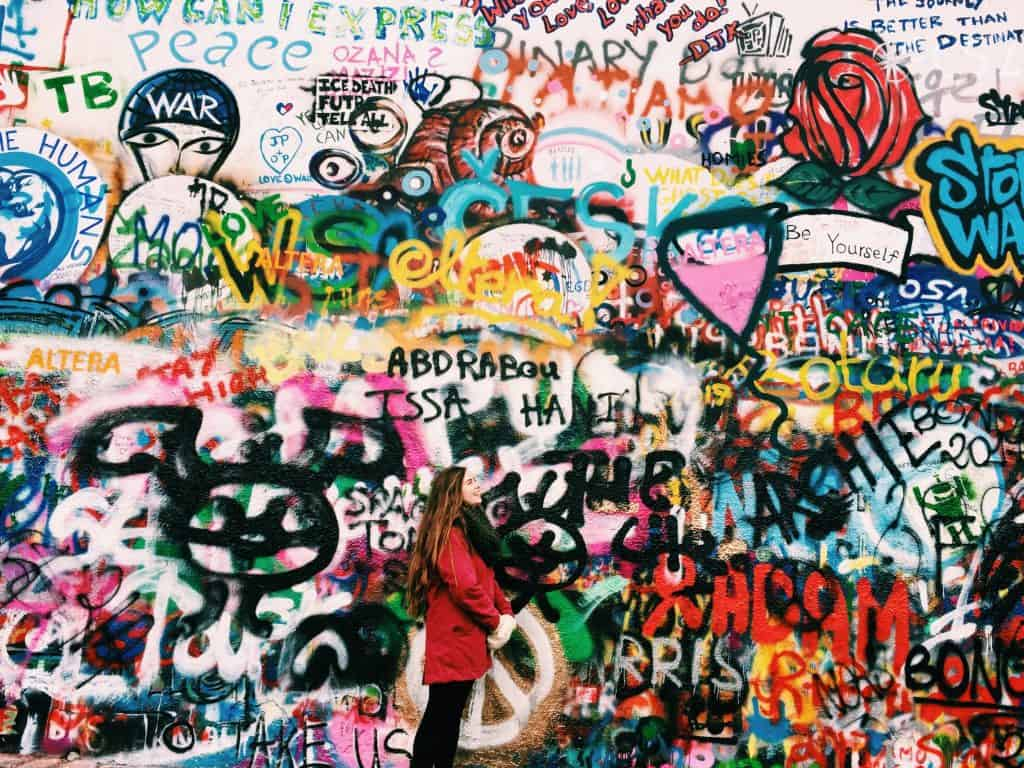 Observing the John Lennon wall in Prague.