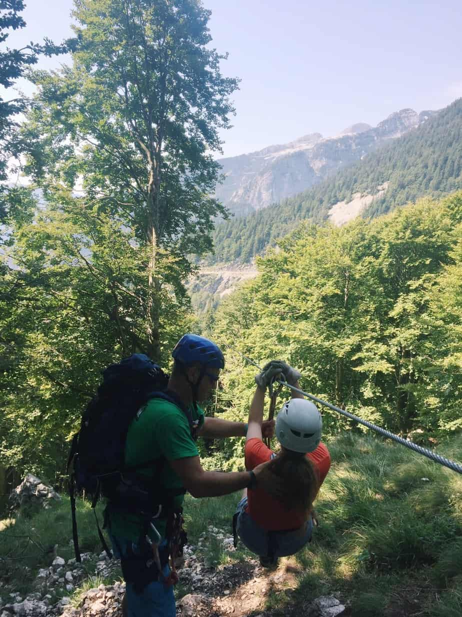 Our guide preparing me for the first zip wire across the alps. You can't go to Slovenia without ziplining with Aktivni Planet in Europe's biggest zipline park. Ziplining in Slovenia is unlike anything else.