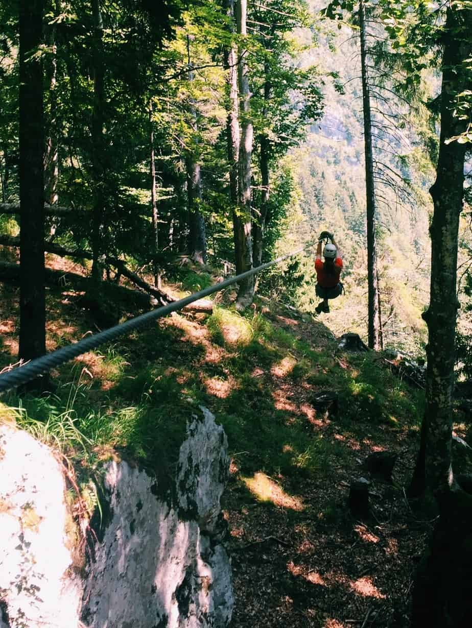 Me zooming off on the zipline into the trees. You can't go to Slovenia without ziplining with Aktivni Planet in Europe's biggest zipline park. Ziplining in Slovenia is unlike anything else.