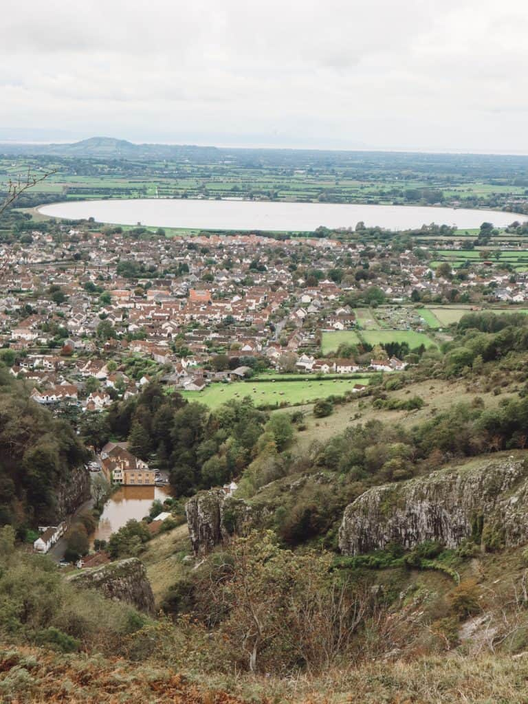 Planning a weekend getaway to Cheddar Gorge and looking for things to do? Check out these 15+ things to do in Cheddar Gorge from walks to the best meals. #cheddargorge #cheddargorgesomerset #somerset #mendips #mendiphills #thingstodoincheddar #thingstodoincheddargorge