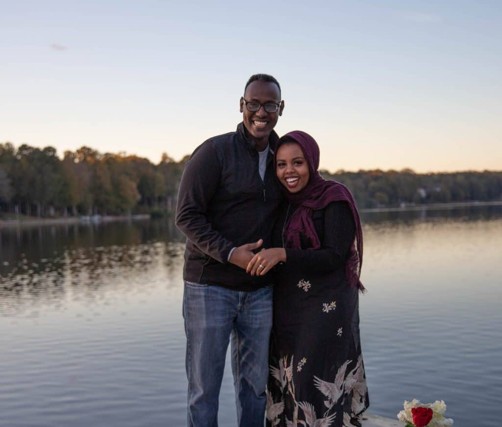 Yasmin and Abdulahi overlooking a lake
