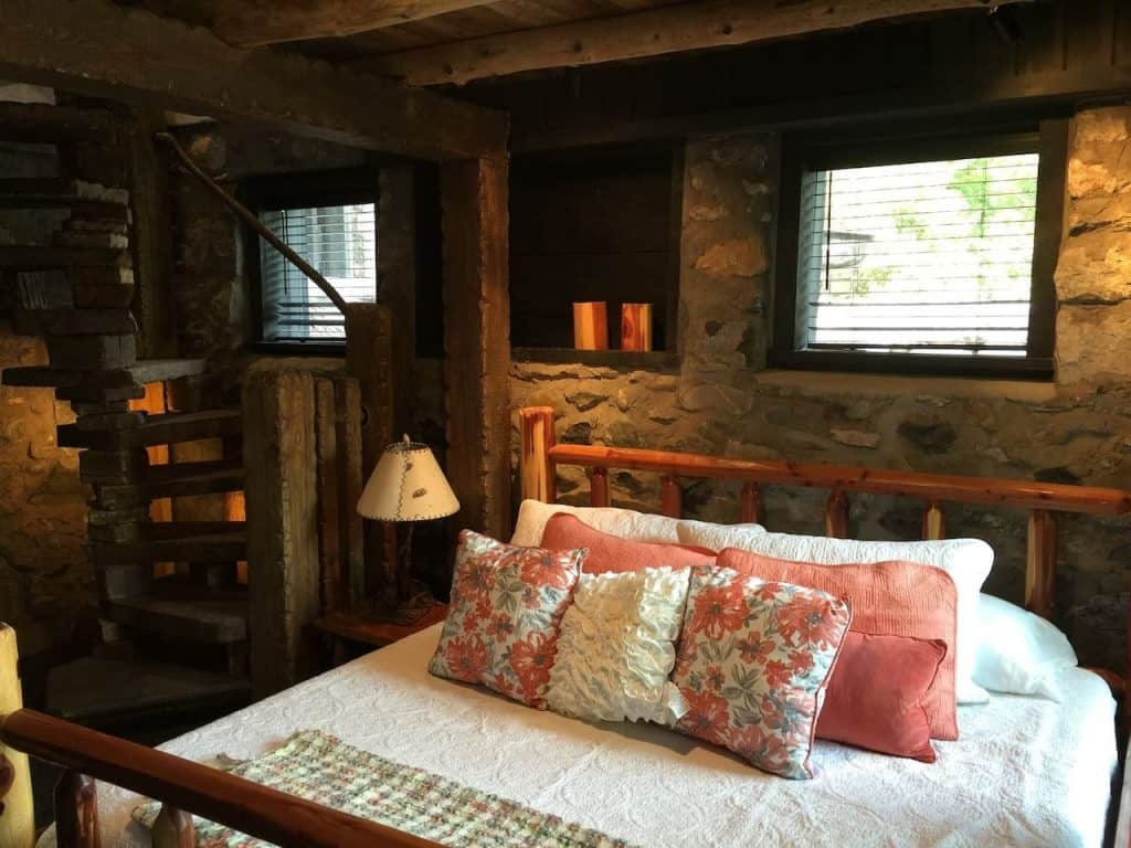 The quaint master bedroom at The Chalet, one of the Charlevoix hobbit homes