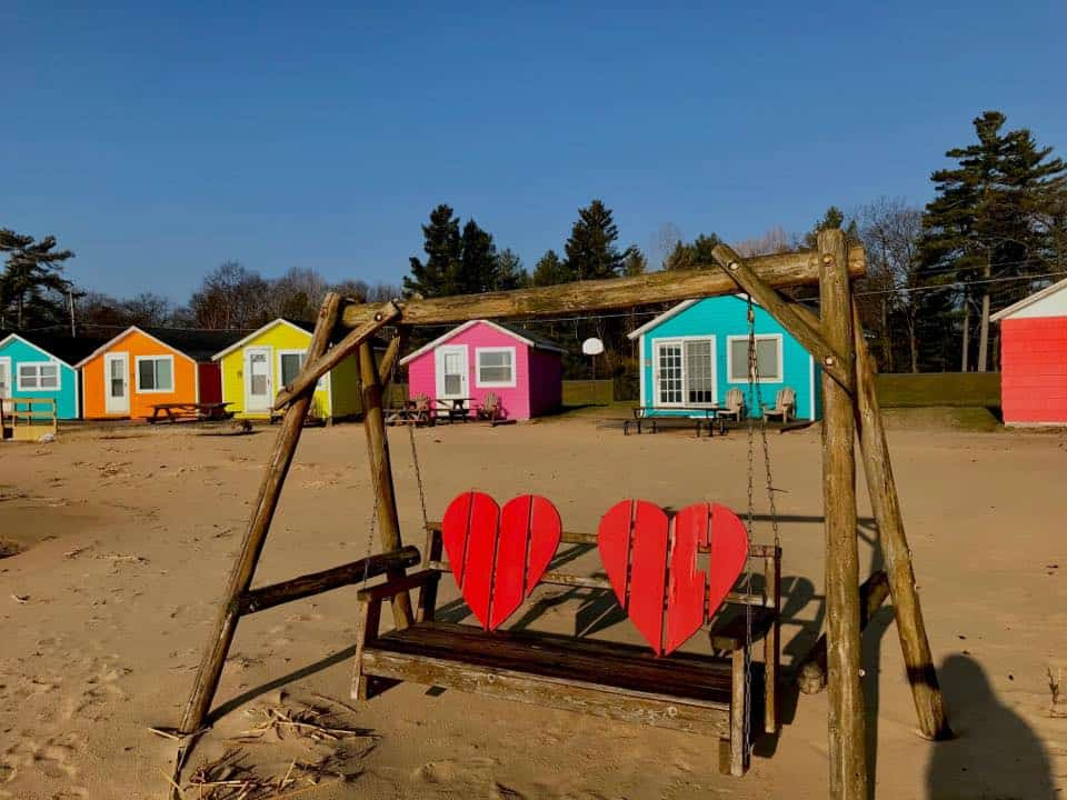 Colorful beach huts along Lake Huron in Michigan at Mai Tiki Resort
