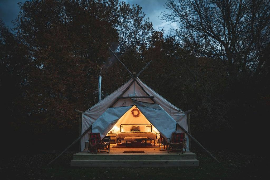 Ready to head Up North - but don't want to bring the tent? Glamping in Michigan is your answer! Check out Michigan's top 15 glamping sites.