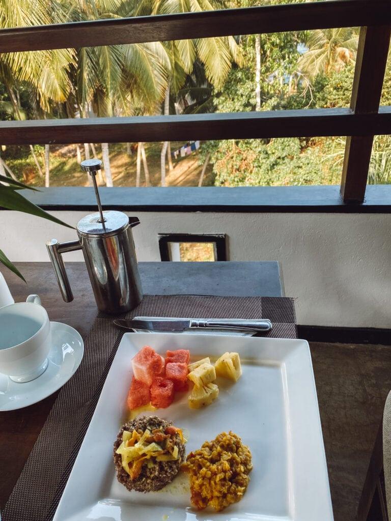 gluten free sri lankan breakfast of puttu and fruit and coffee