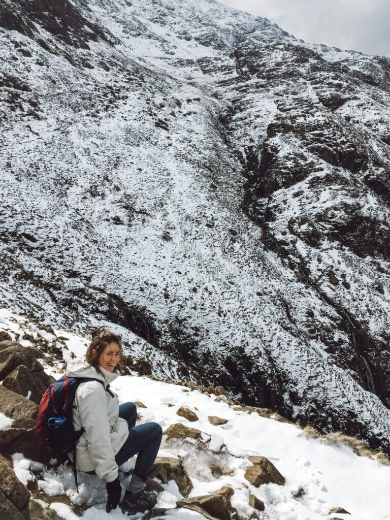Sarah sitting on the edge at Scaffel Pike - Keswick walks