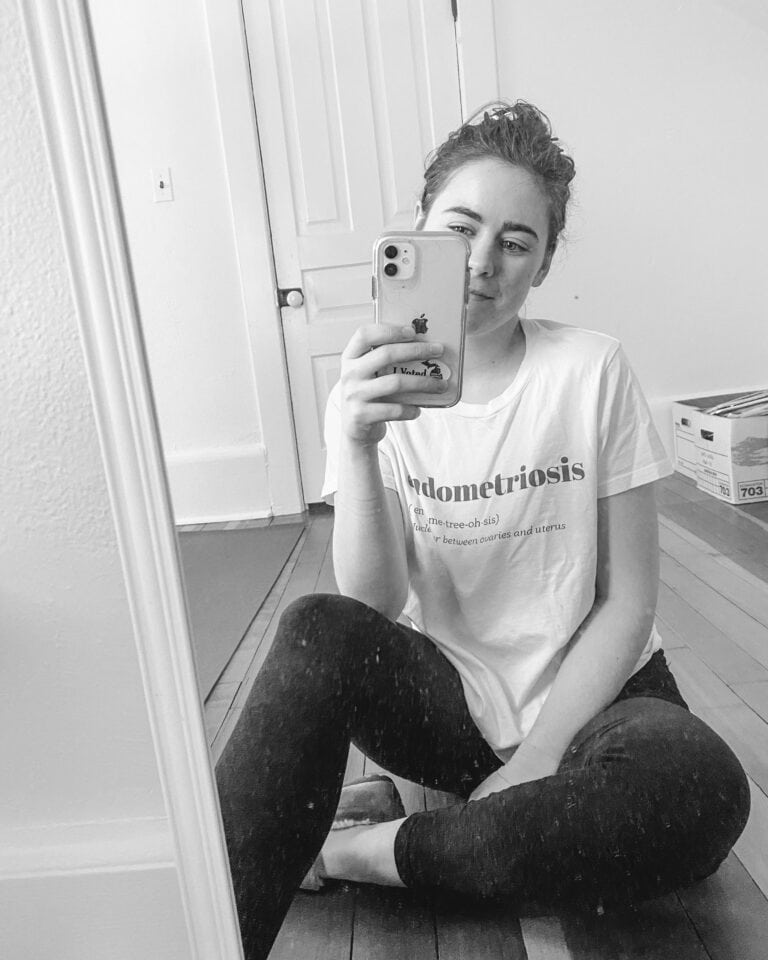 my journey with endometriosis, sarah sitting in front of mirror in endo shirt in black and white